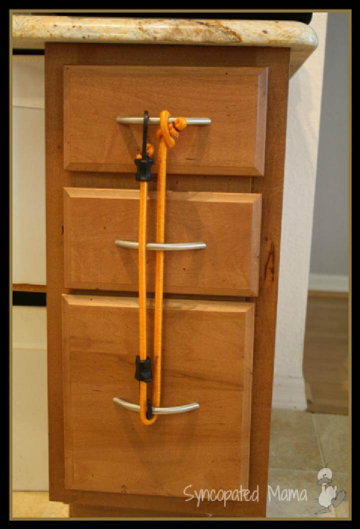 Baby Proof Cabinets DIY  28 Ways To Use Bungee Cords in Your Home DIY Bungee Cord