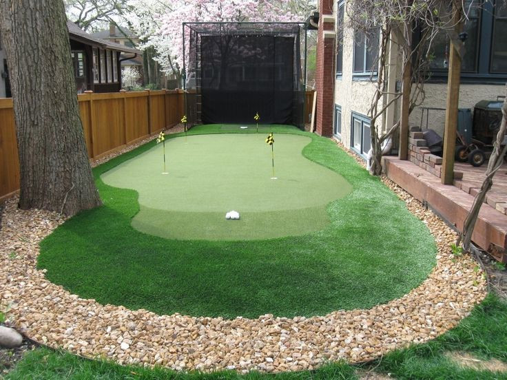 Best ideas about Backyard Putting Green . Save or Pin Traditional Landscape Yard with Backyard Golf Cage Fence Now.