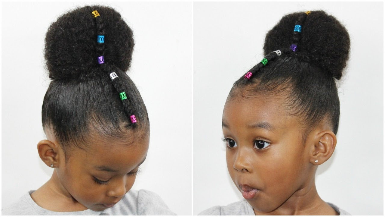 Best ideas about Bun Hairstyles For Kids . Save or Pin Rainbow Bun with Cornrow Now.