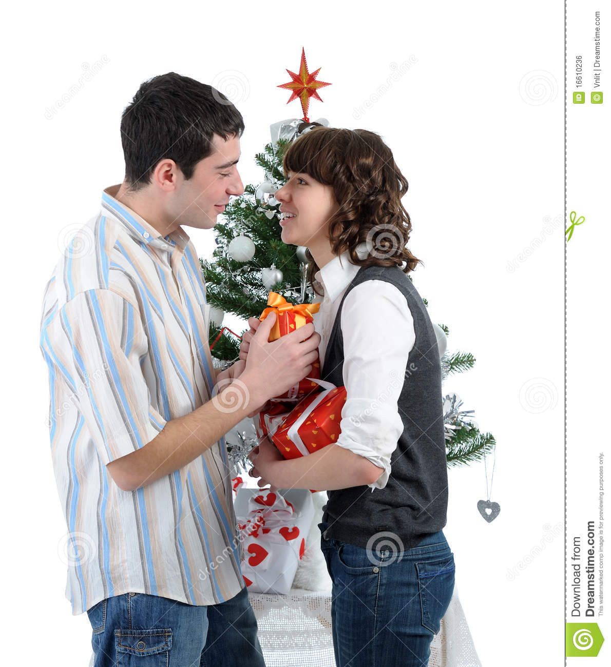 Best ideas about Christmas Gift Ideas For Young Couples . Save or Pin Happy Young Couple With Christmas Gifts Royalty Free Stock Now.