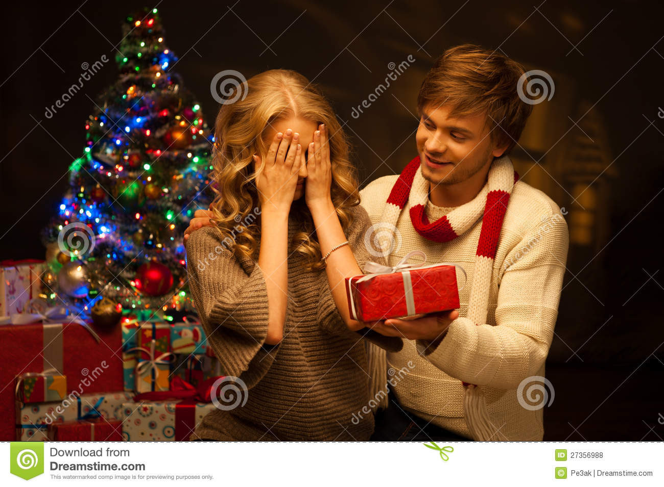 Best ideas about Christmas Gift Ideas For Young Couples . Save or Pin Young Couple Presenting Christmas Gift Royalty Free Stock Now.