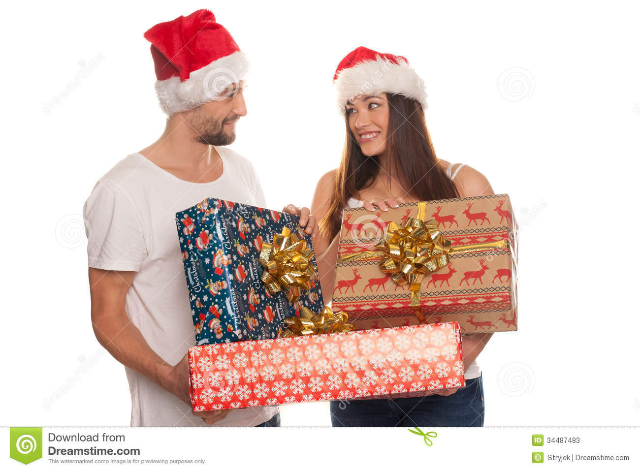 Best ideas about Christmas Gift Ideas For Young Couples . Save or Pin Smiling Young Couple With Xmas Gifts Stock s Now.