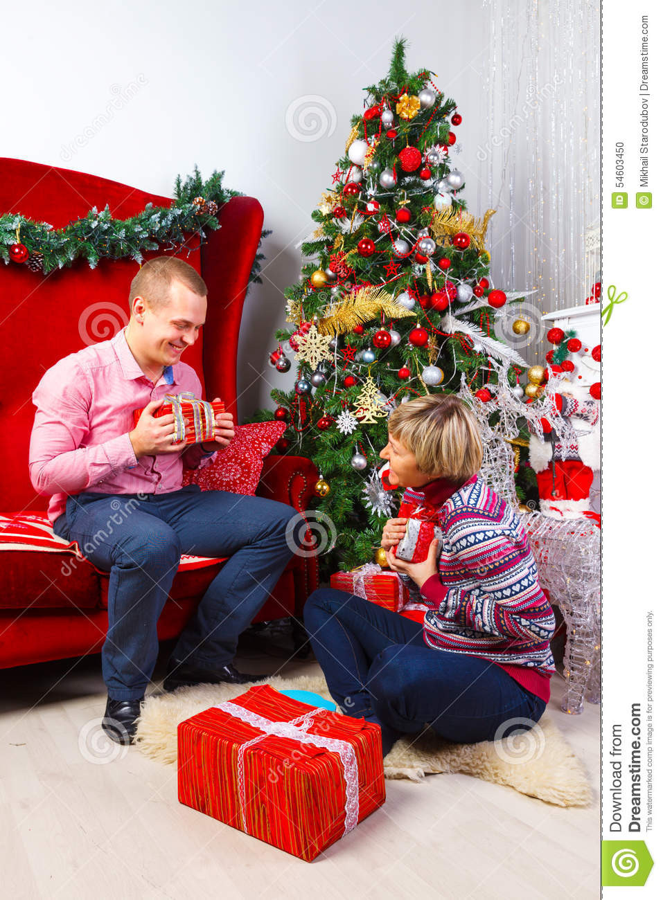 Best ideas about Christmas Gift Ideas For Young Couples . Save or Pin Happy Young Couple With Gifts At New Year Stock Now.
