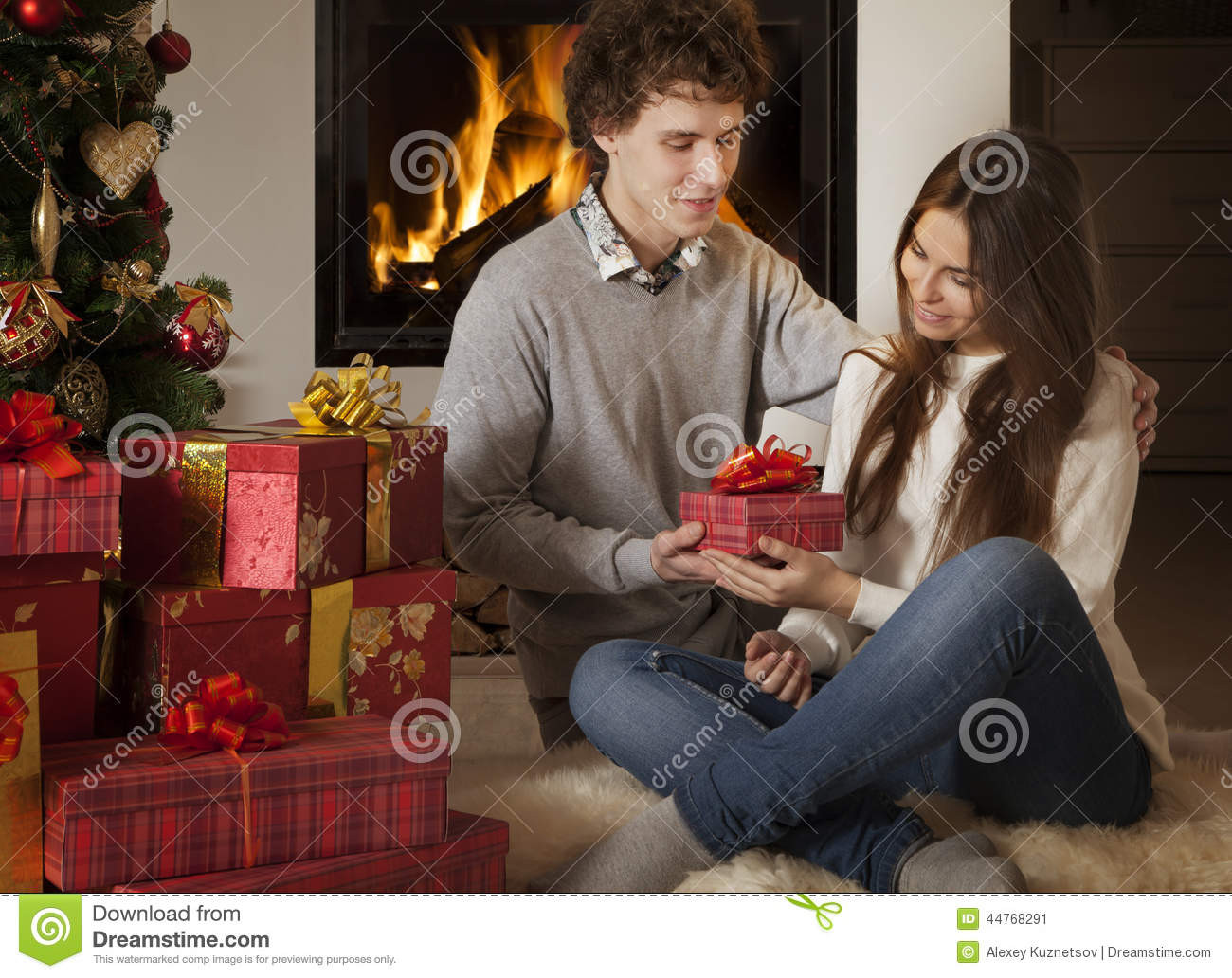 Best ideas about Christmas Gift Ideas For Young Couples . Save or Pin Young Couple With Christmas Presents Stock Image Now.
