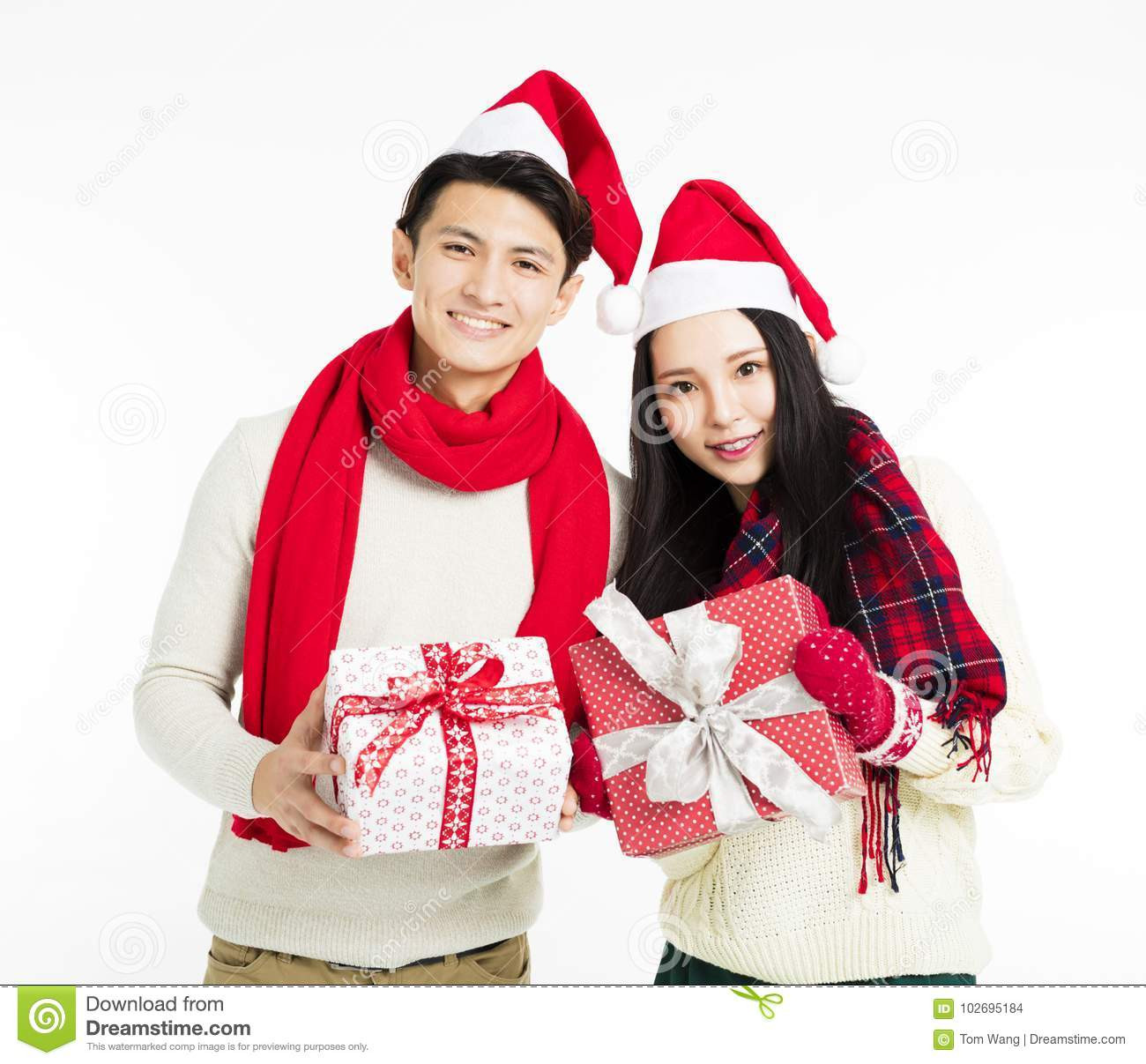 Best ideas about Christmas Gift Ideas For Young Couples . Save or Pin Young Couple Showing Christmas Gifts Stock Image Now.