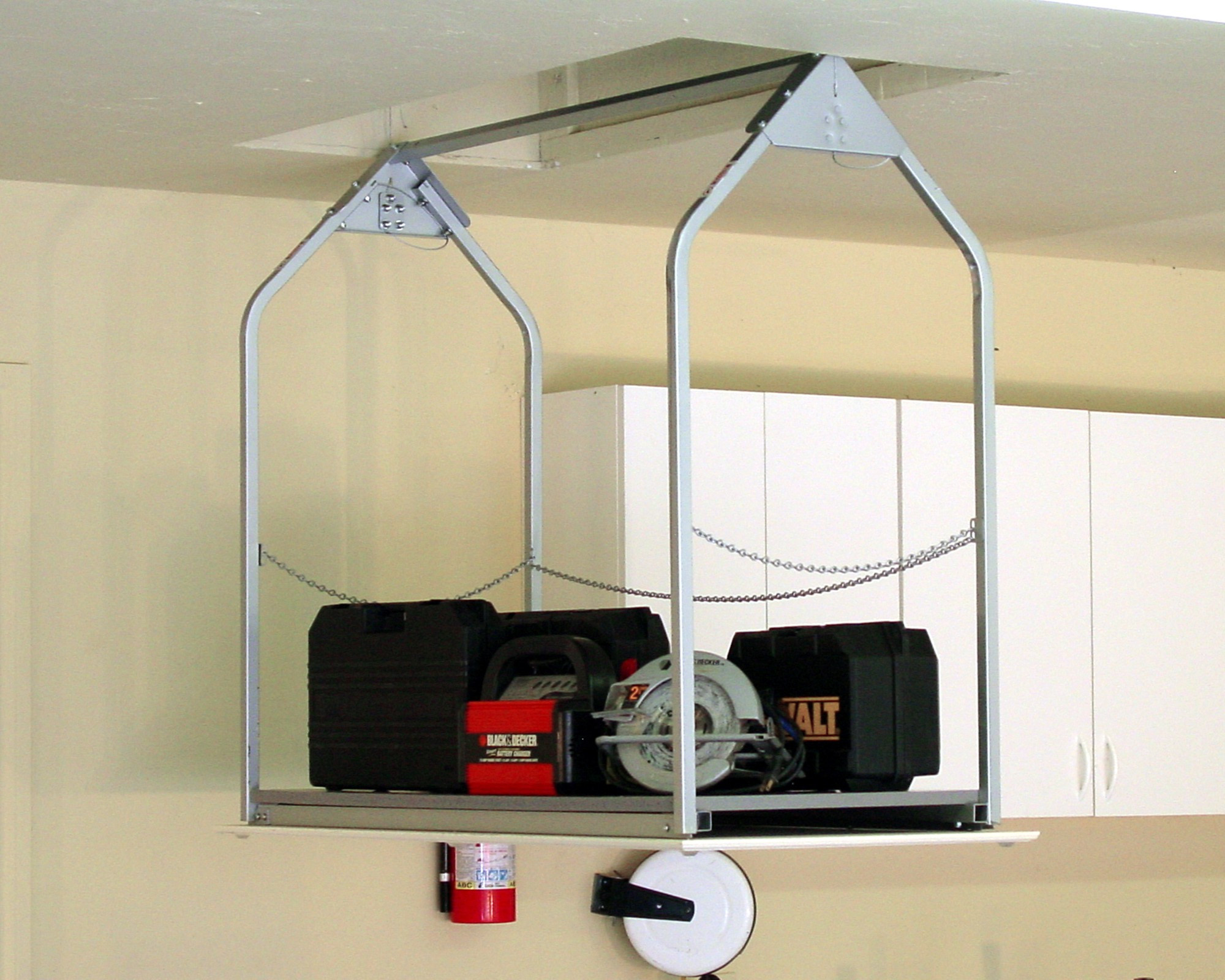 Best ideas about Garage Ceiling Storage Lift . Save or Pin Attic Saddle Storage System • Attic Ideas Now.