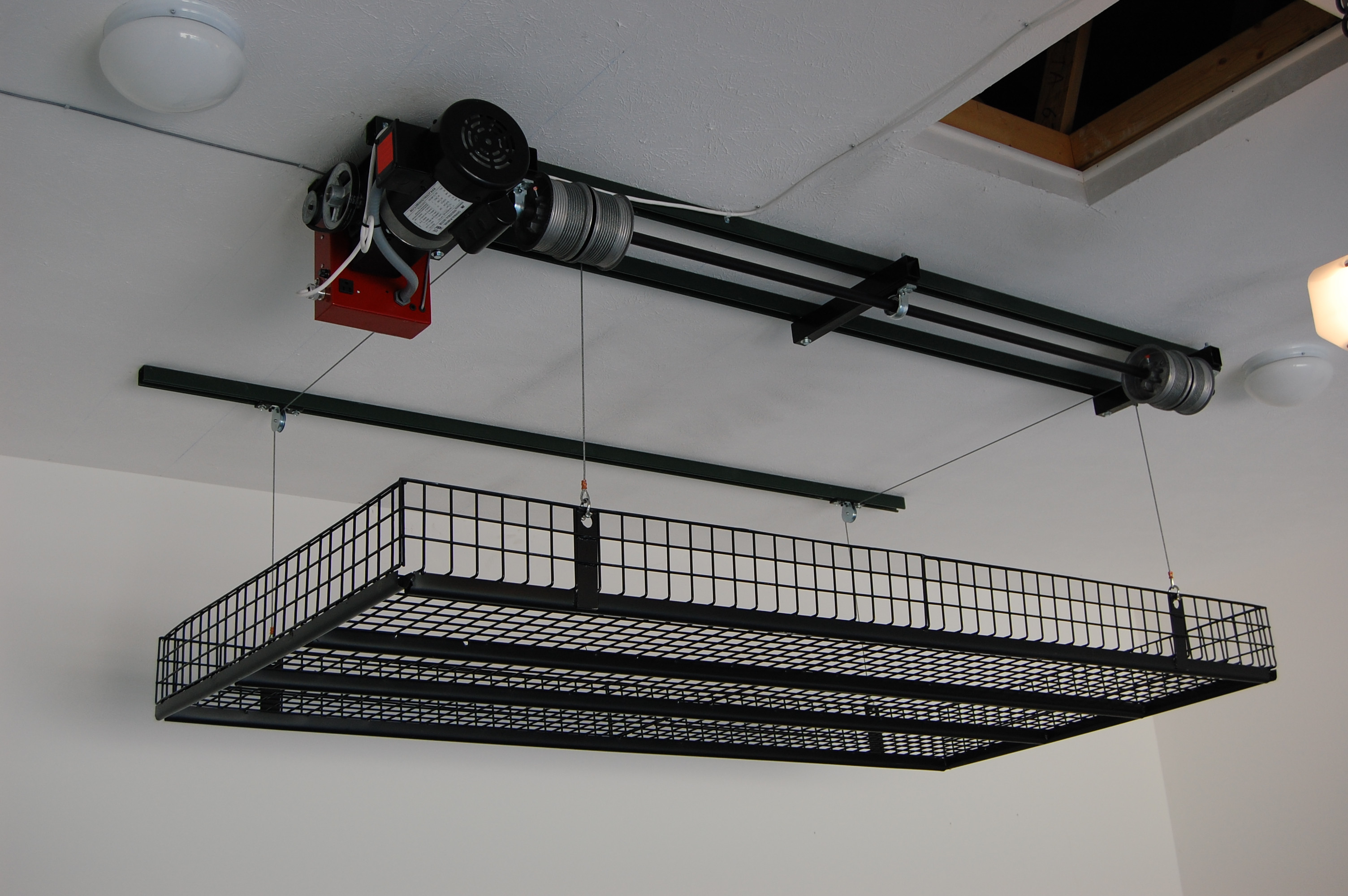 Best ideas about Garage Ceiling Storage Lift . Save or Pin Garage storage products that make every inch count Now.
