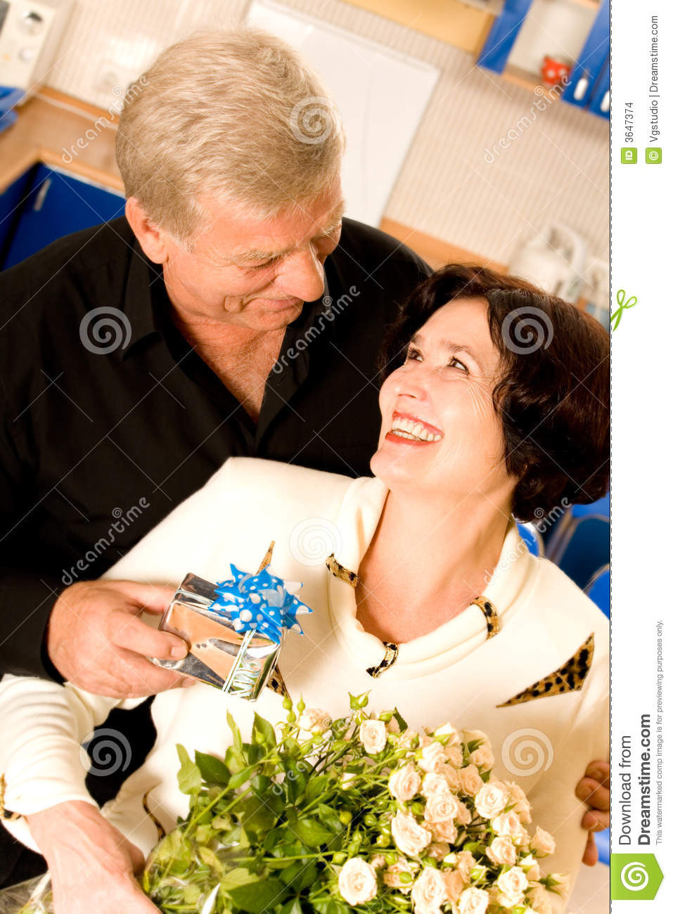 Best ideas about Gift Ideas For Older Couples . Save or Pin Mature Couple With Gifts Stock Image Now.
