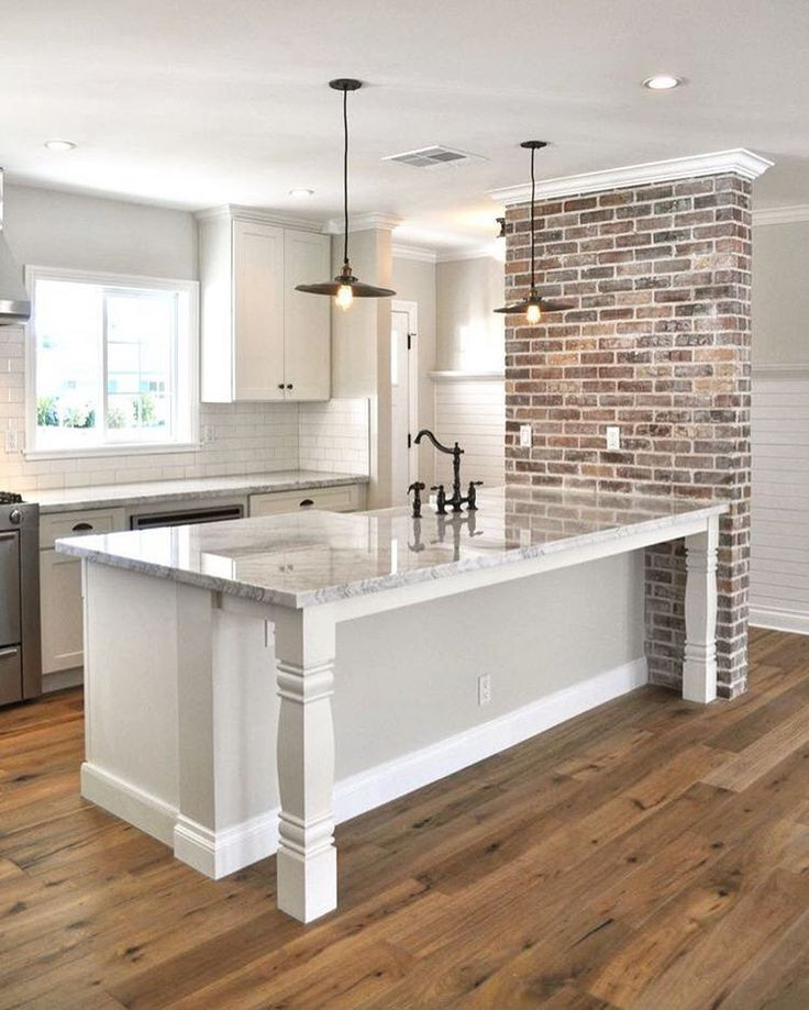 Best ideas about Kitchens With Brick Accent Walls . Save or Pin kitchen counter table bar wood floors subway tile and Now.