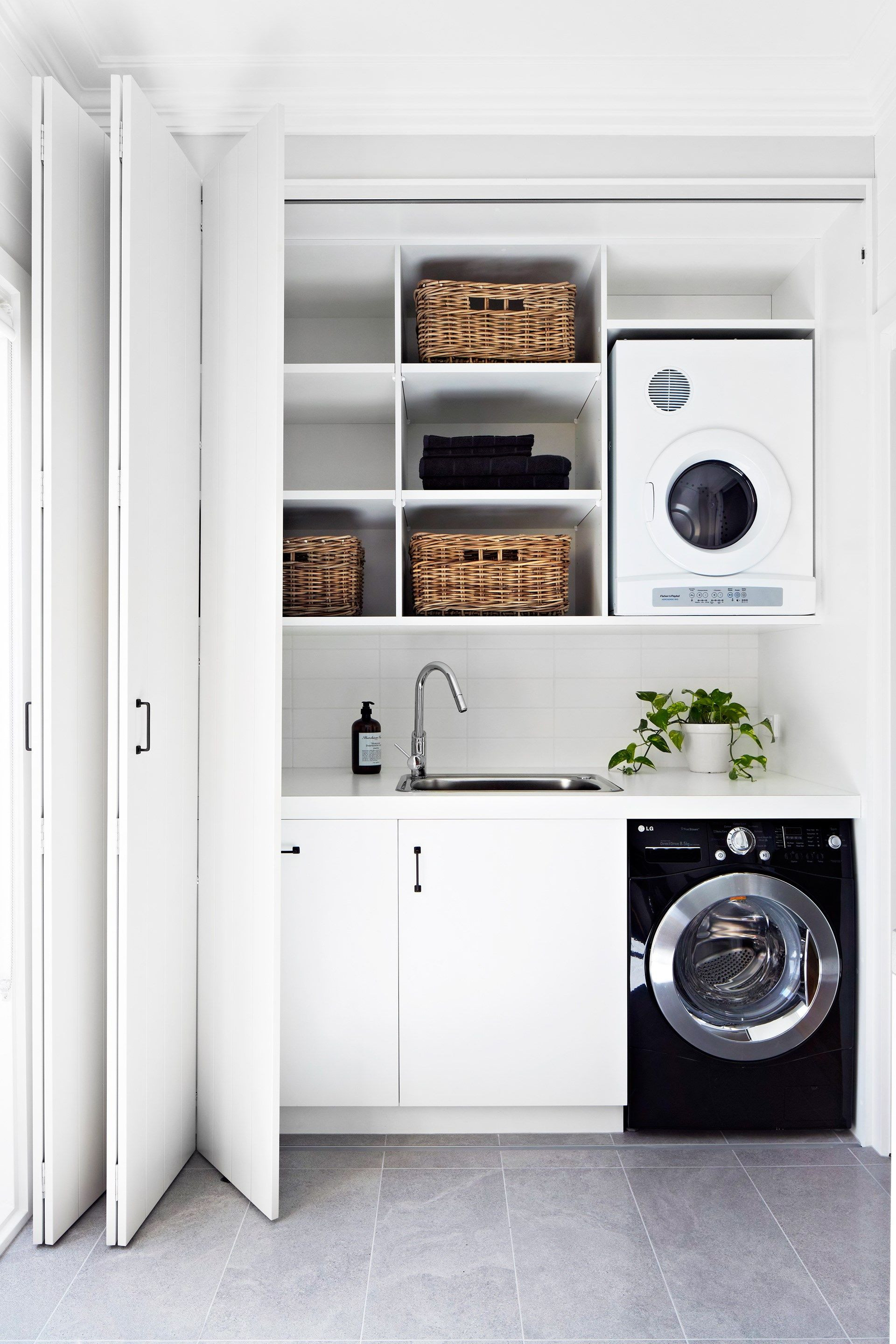 Best ideas about Laundry In Kitchen . Save or Pin Smart Design Ideas to Steal for Small Laundry Rooms Now.