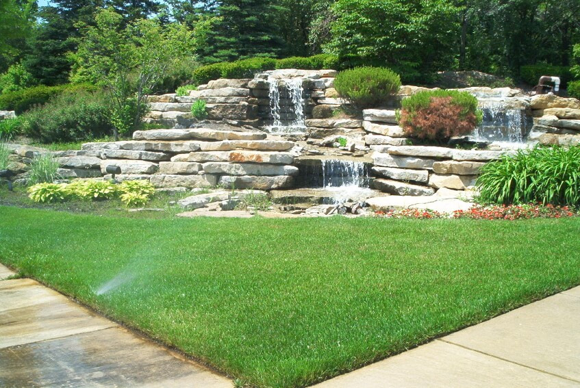 Best ideas about Backyard Waterfall Ideas . Save or Pin Layered stone waterfall in a corner of a backyard Now.