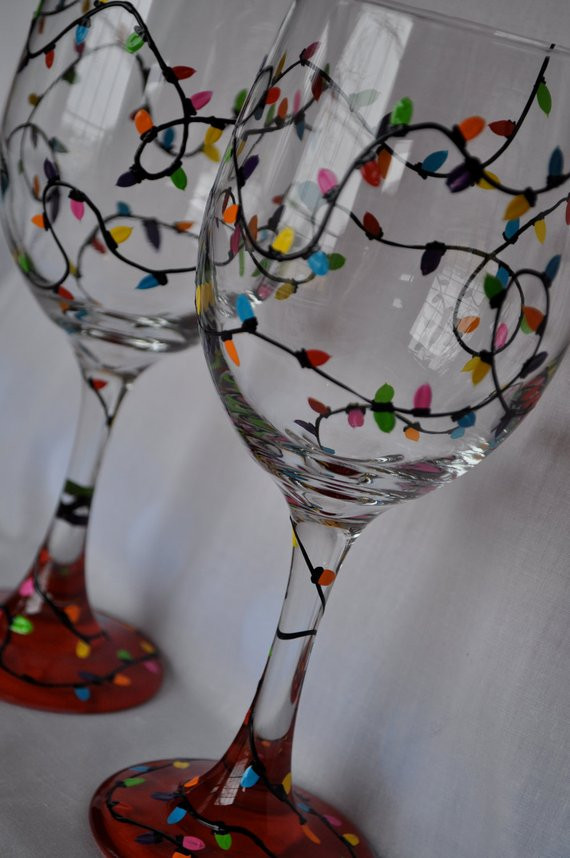 Best ideas about DIY Christmas Wine Glasses . Save or Pin Hand Painted Christmas Lights Wine Glass Pair Now.