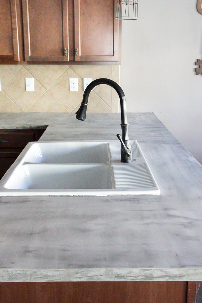 Best ideas about DIY Concrete Countertops . Save or Pin DIY Feather Finish Concrete Countertops Bless er House Now.