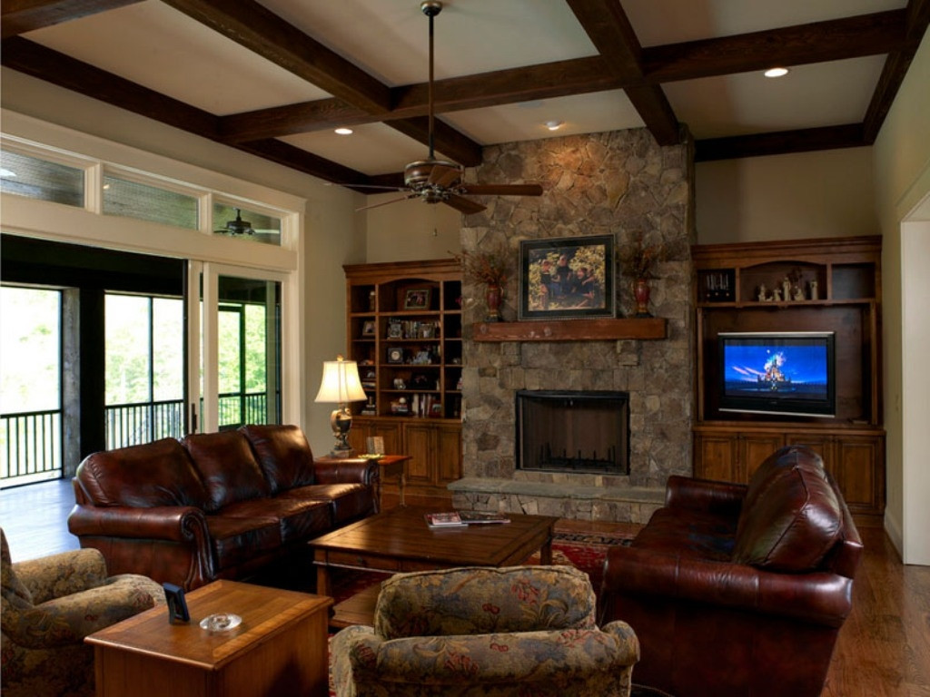 Best ideas about Family Room Designs . Save or Pin Stone Fireplace With Floral Couch And Coffee Brown Leather Now.