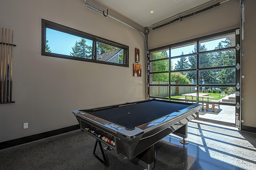 Best ideas about Modern Game Room . Save or Pin Modern Game Room with Built in bookshelf & Concrete floors Now.