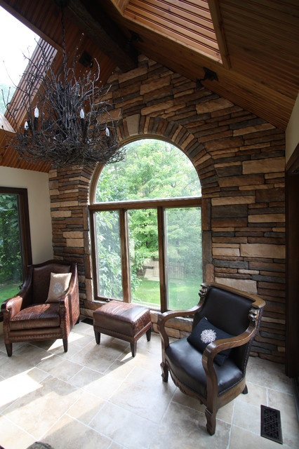 Best ideas about Stacked Stone Accent Wall . Save or Pin Stacked Stone Accent Wall Traditional Family Room Now.