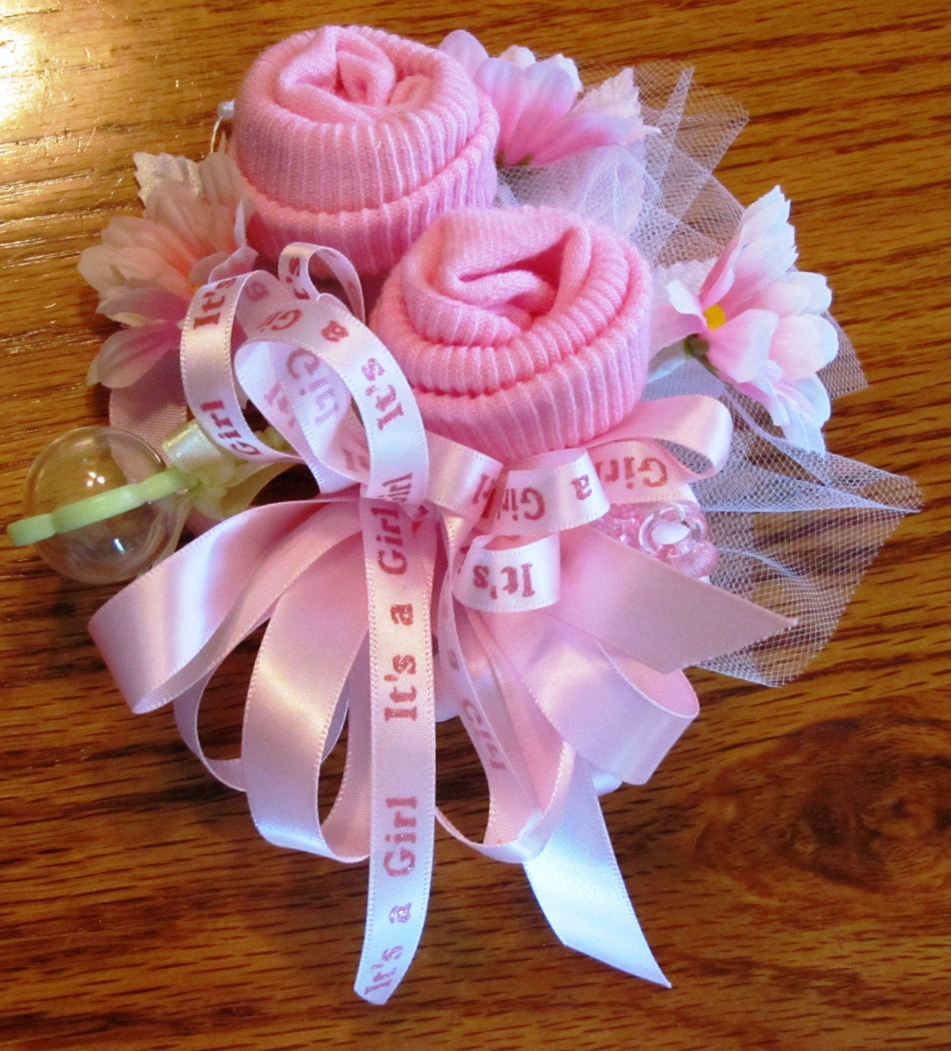 Best ideas about Baby Shower Corsages DIY . Save or Pin Baby Sock corsage Handmade baby sock shower corsage Baby Now.