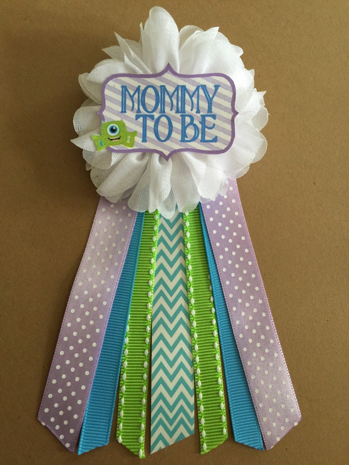 Best ideas about Baby Shower Corsages DIY . Save or Pin Little Monsters Baby Shower corsage pin Mommy to be by Now.