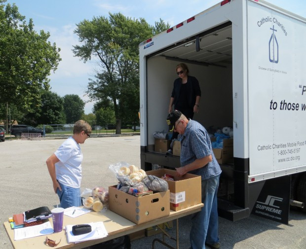 Best ideas about Catholic Charities Food Pantry . Save or Pin Catholic Charities using mobile food pantry suburban Now.