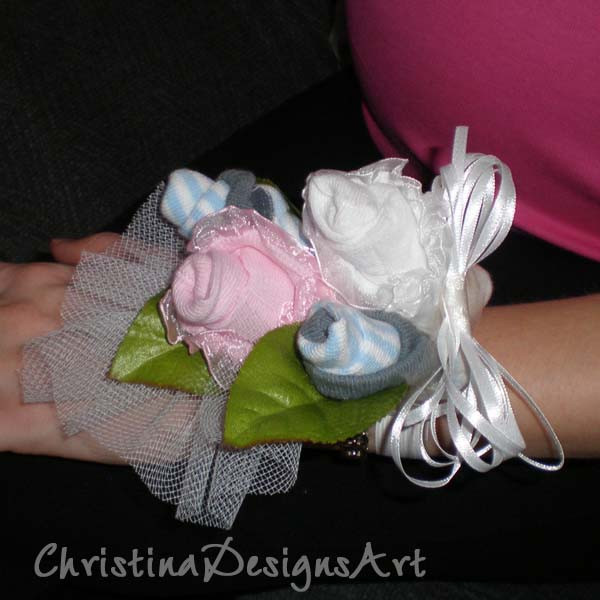 Best ideas about DIY Baby Shower Corsage . Save or Pin Baby Shower Diaper Cakes & Sock Corsages Now.
