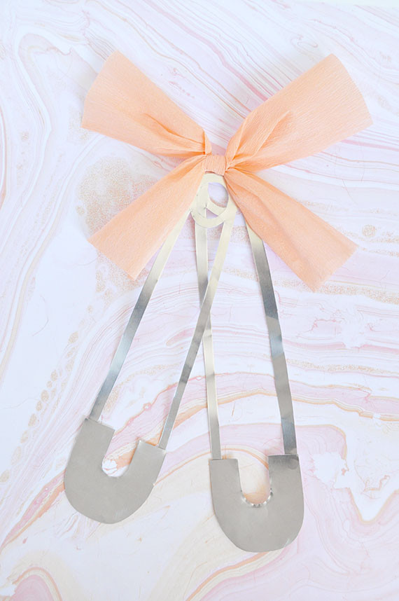 Best ideas about DIY Baby Shower Pins . Save or Pin DIY Oversize Diaper Pins for a Baby Shower Now.
