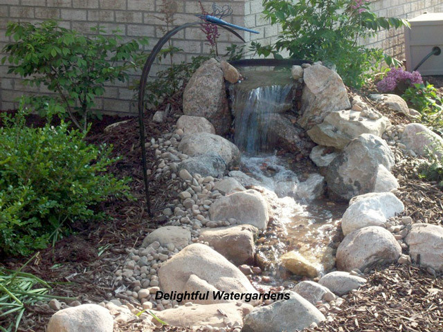 Best ideas about Diy Backyard Waterfall . Save or Pin Weekend DIY Backyard Water Feature Now.