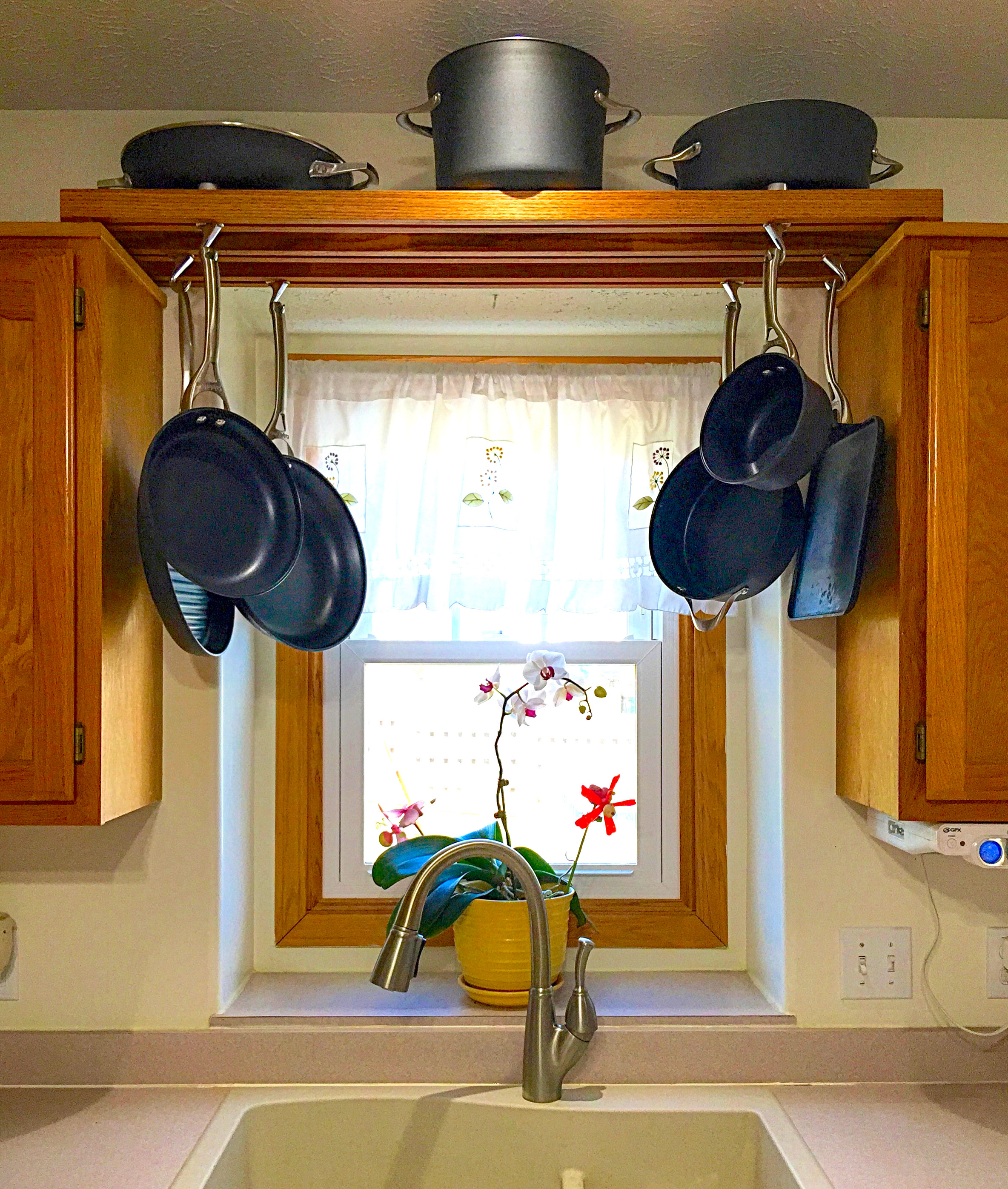 Best ideas about DIY Hanging Pot Racks . Save or Pin Make use of space over the kitchen sink with this DIY pot Now.