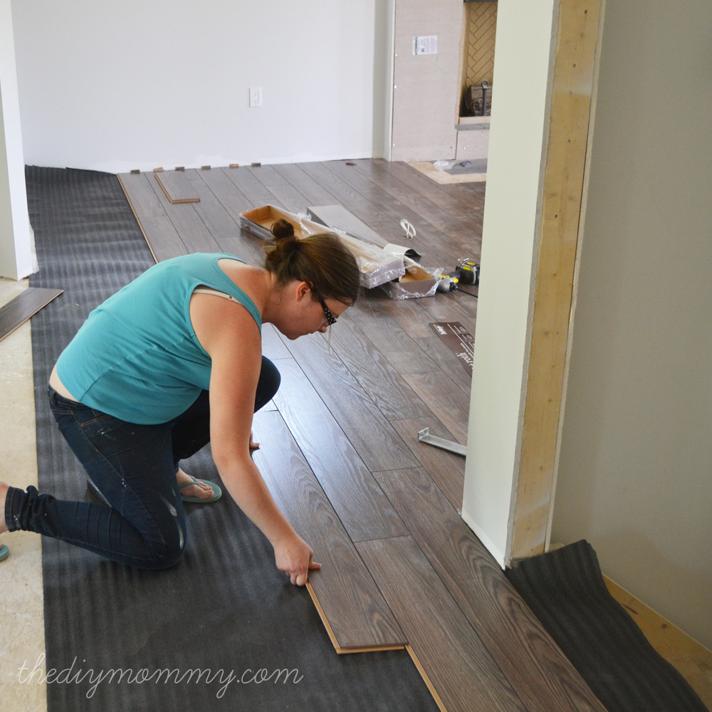 Best ideas about DIY Hardwood Floor Install . Save or Pin Installing Our Laminate Flooring – Our DIY House Now.