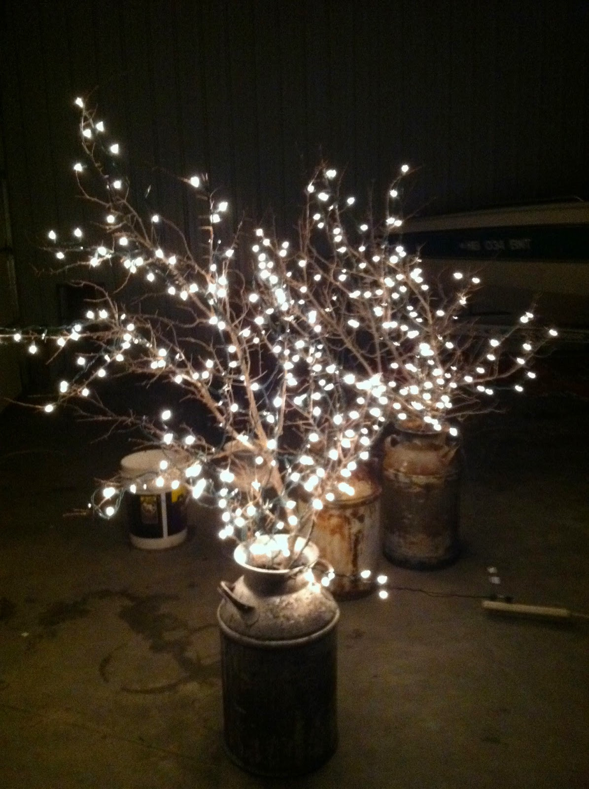 Best ideas about DIY Wedding Lighting . Save or Pin DIY Why Spend More Milk cans branches white lights Now.