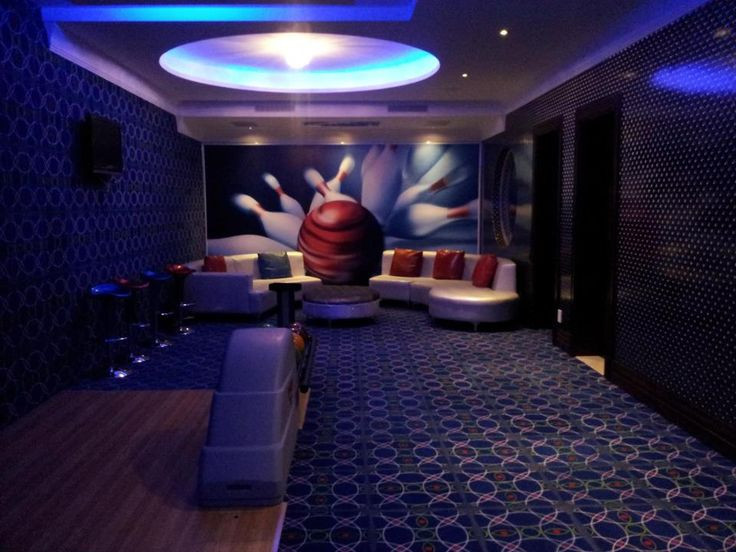 Best ideas about Game Room Seating . Save or Pin Seating area for home bowling alley with wall mural Now.