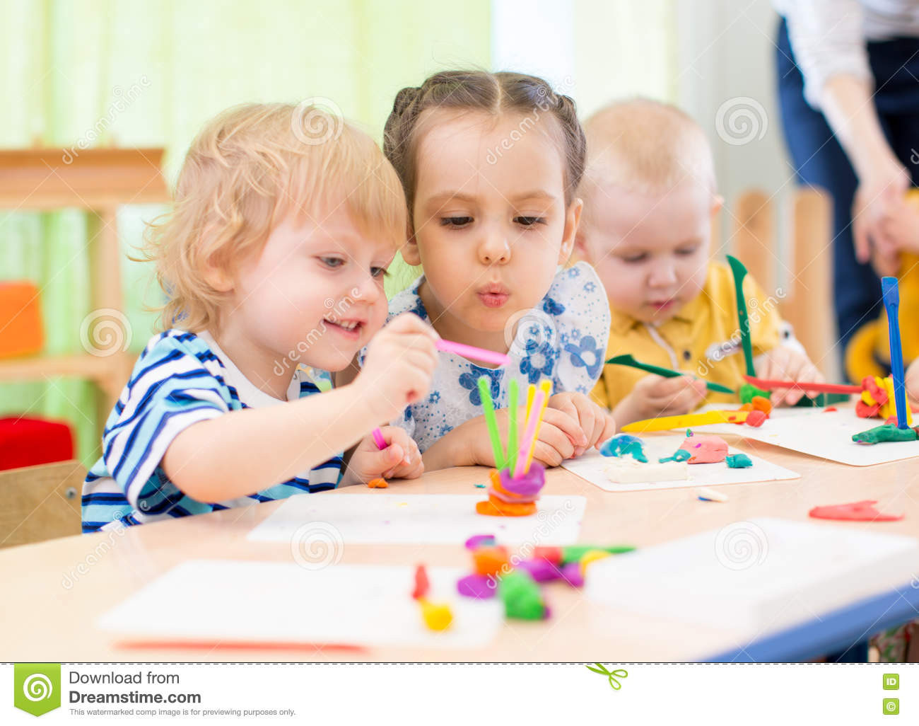 Best ideas about Kids Doing Crafts . Save or Pin Happy Kids Doing Arts And Crafts In Day Care Centre Stock Now.