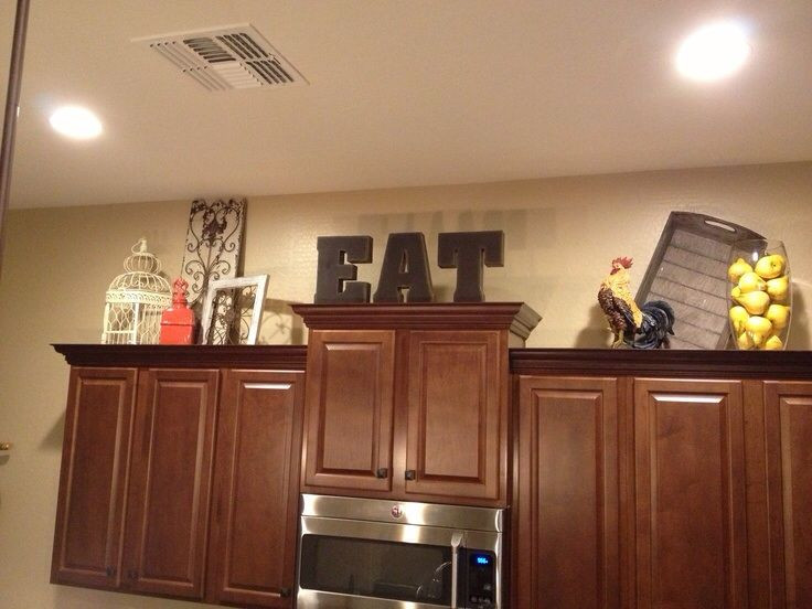 Best ideas about Kitchen Decorating Pinterest . Save or Pin cabinet decor Kitchen decorations Now.