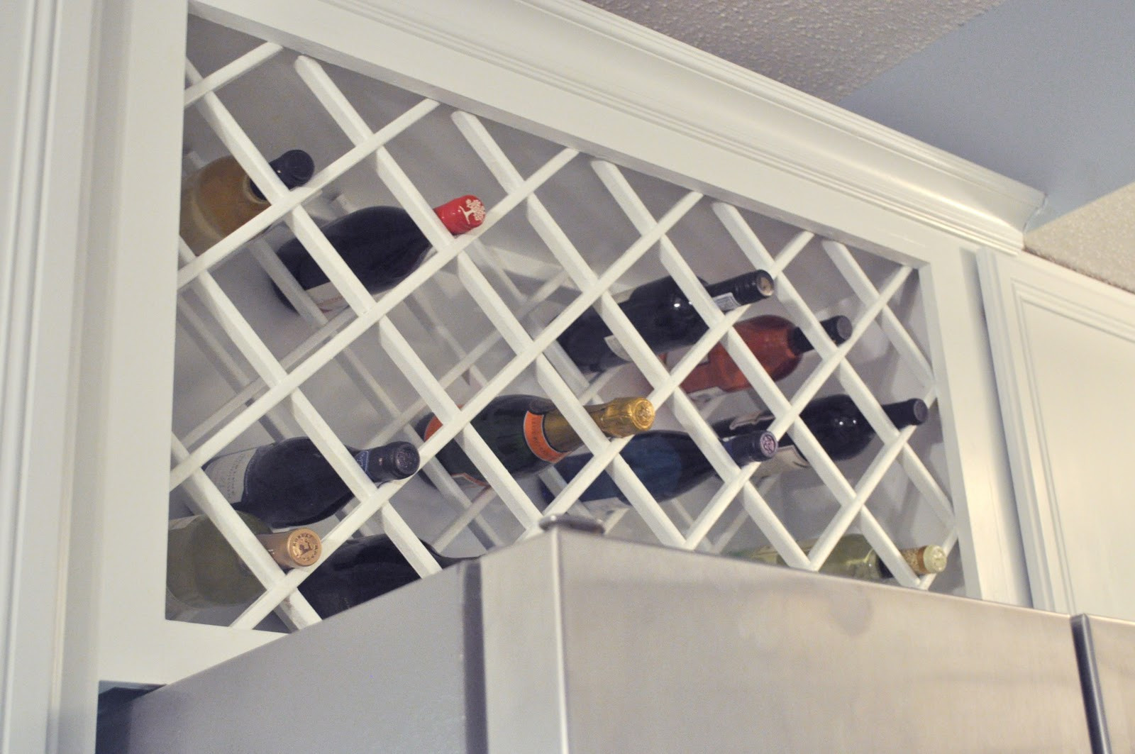 Best ideas about Lattice Wine Rack DIY . Save or Pin Not So Newlywed McGees Cabinet Wine Lattice Now.
