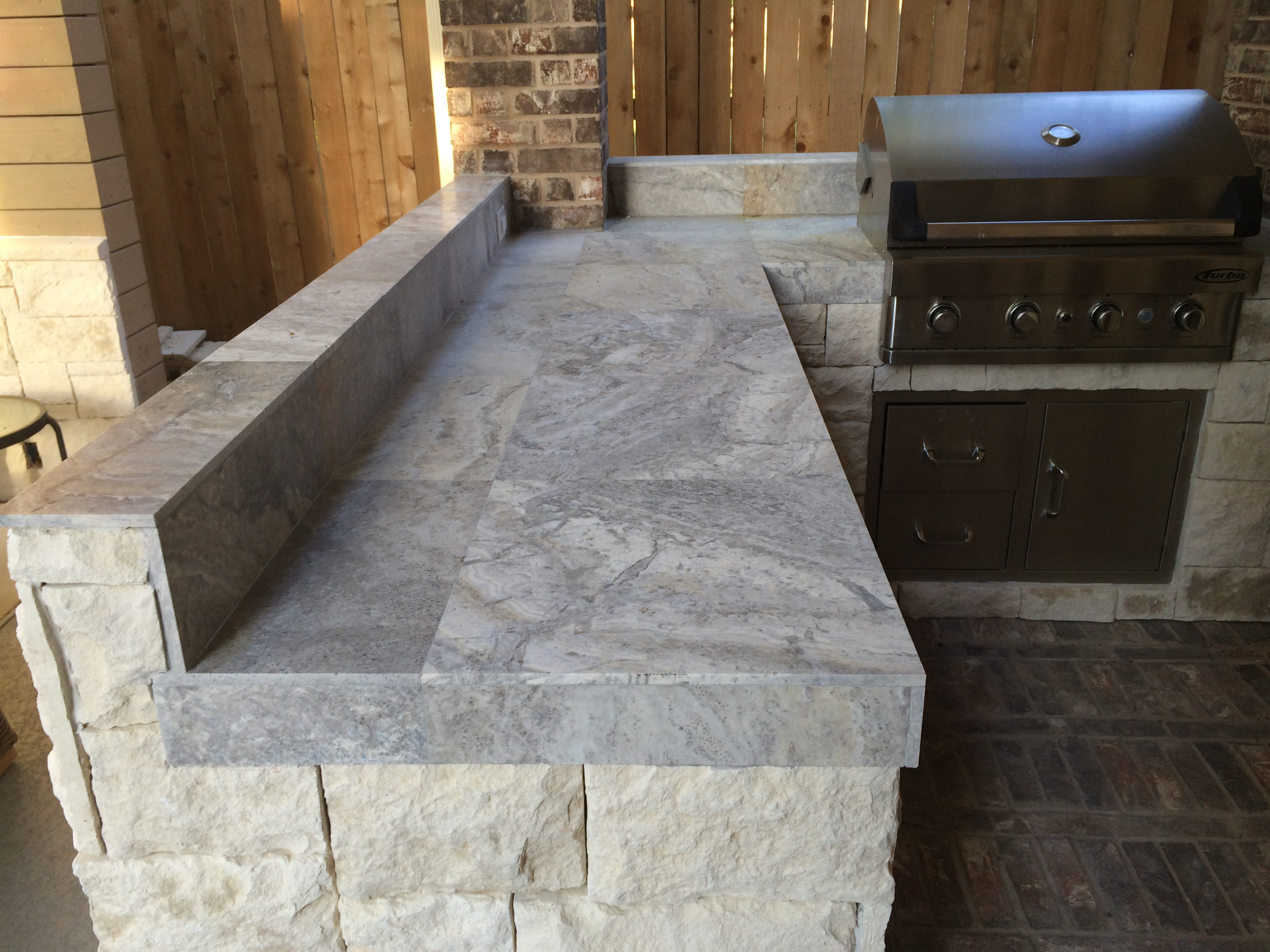 Best ideas about Outdoor Kitchen Countertops . Save or Pin Houston Outdoor Kitchen With Silver Travertine Tile Countertop Now.