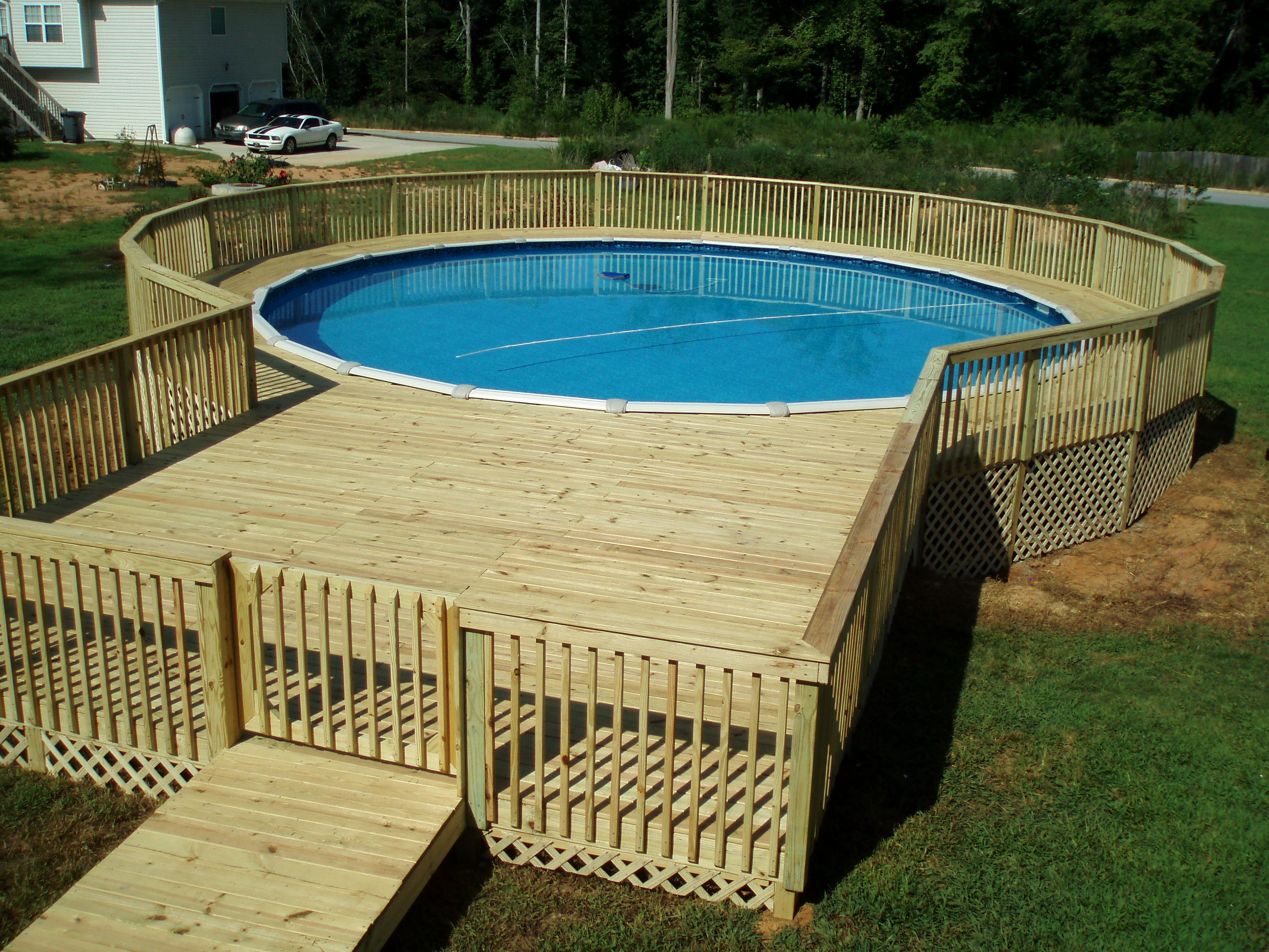 Best ideas about Pool Decks For Above Ground Pools . Save or Pin Simple Ground Pool Deck Ideas Now.