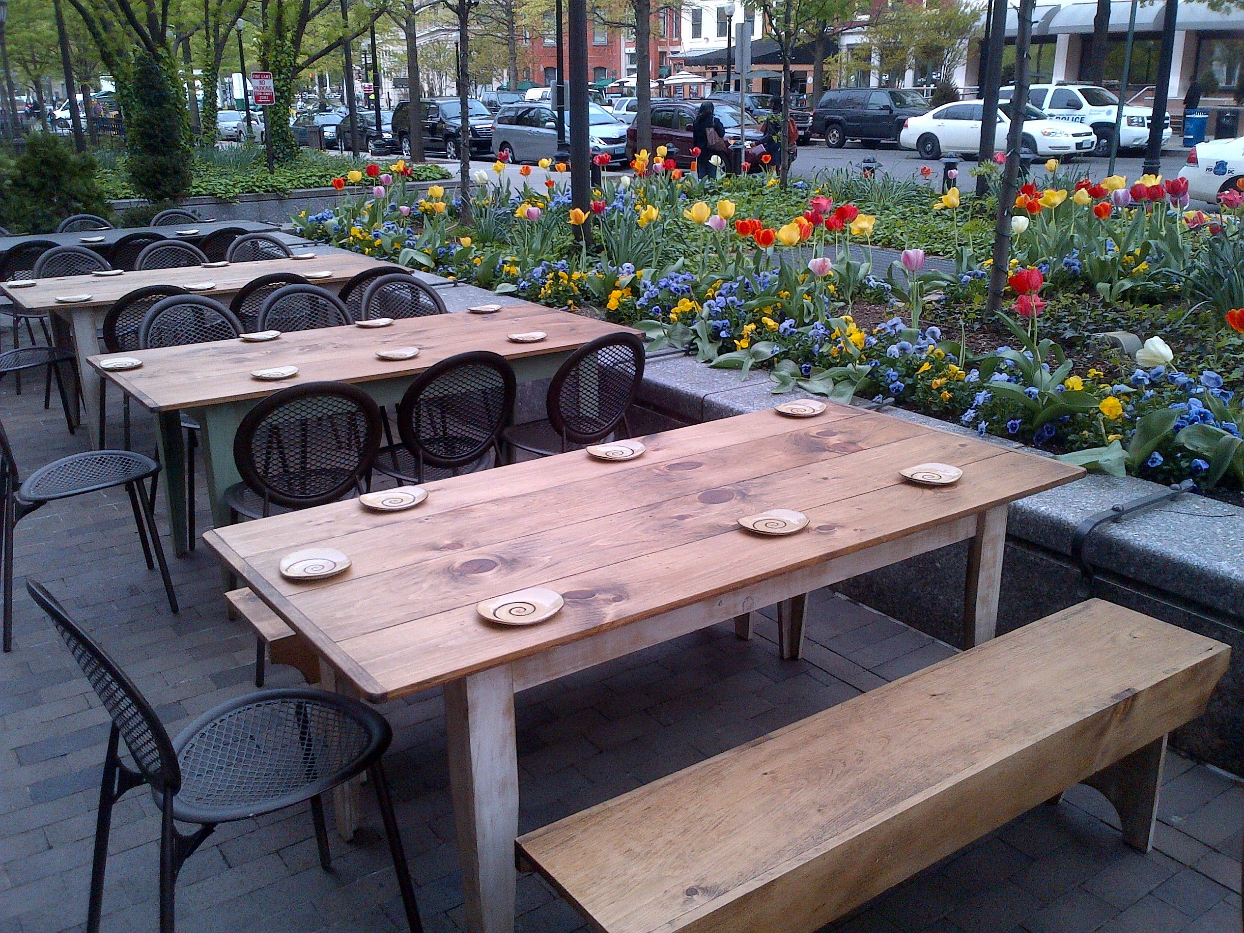 Best ideas about Restaurant Patio Furniture . Save or Pin Nice spring flowers and tulips around an outside patio at Now.