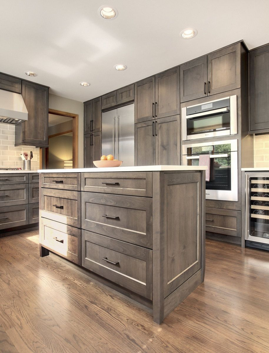 Best ideas about Stained Kitchen Cabinets . Save or Pin alder gray stained cabinetry soft white quartz Now.