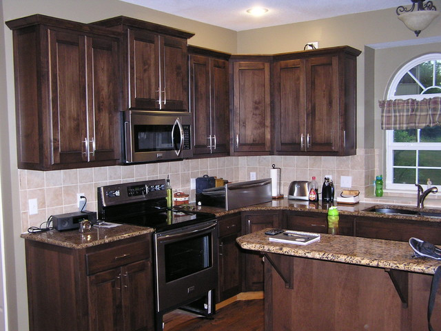 Best ideas about Stained Kitchen Cabinets . Save or Pin Kitchen Cabinet Refacing in a Mediterranean Stain Now.