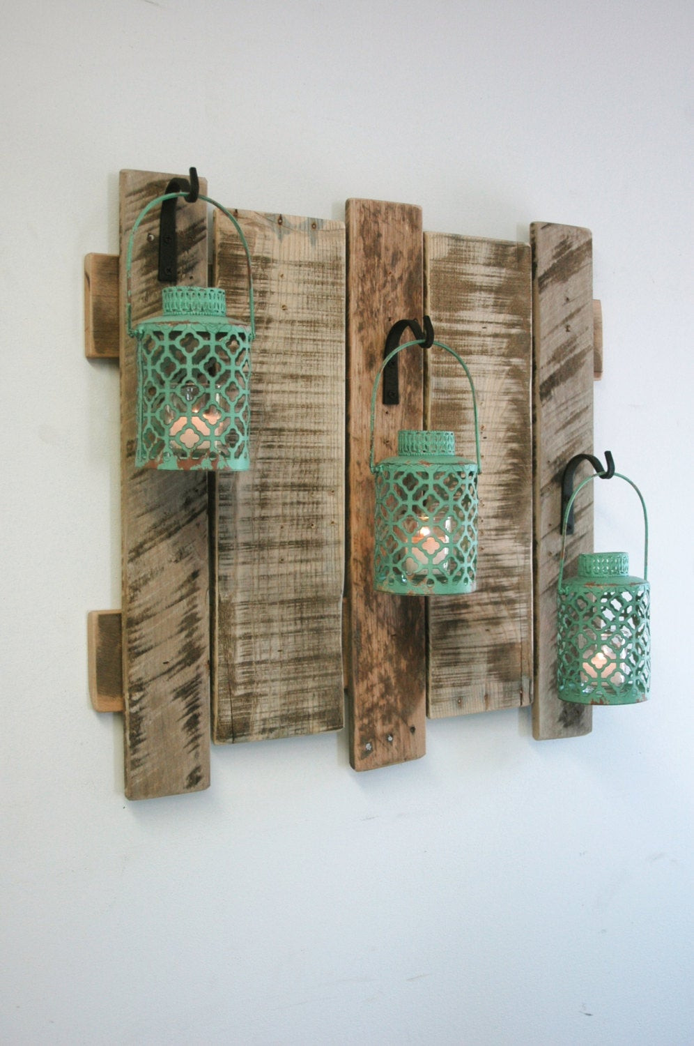 Best ideas about Wall Art Decor . Save or Pin Pallet wall decor with Antique Turquoise Metal Lanterns Now.