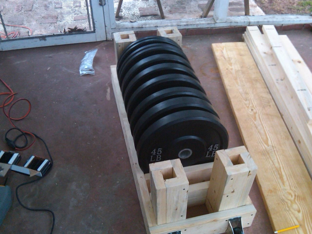 Best ideas about Bumper Plate Storage DIY . Save or Pin Great Design for a Plate Rack with Bar Storage photo 1 Now.