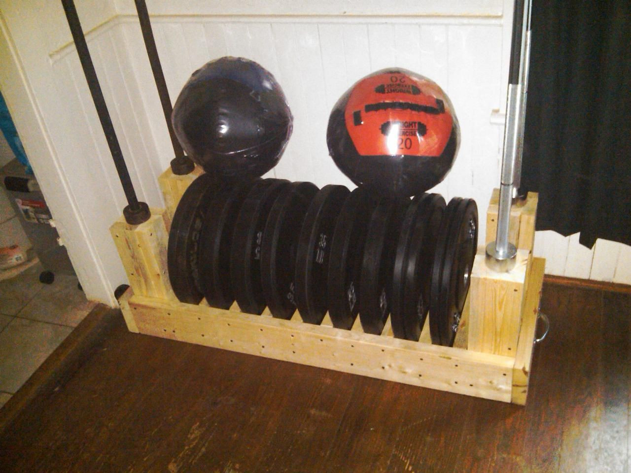 Best ideas about Bumper Plate Storage DIY . Save or Pin Great Design for a Plate Rack with Bar Storage photo 2 Now.