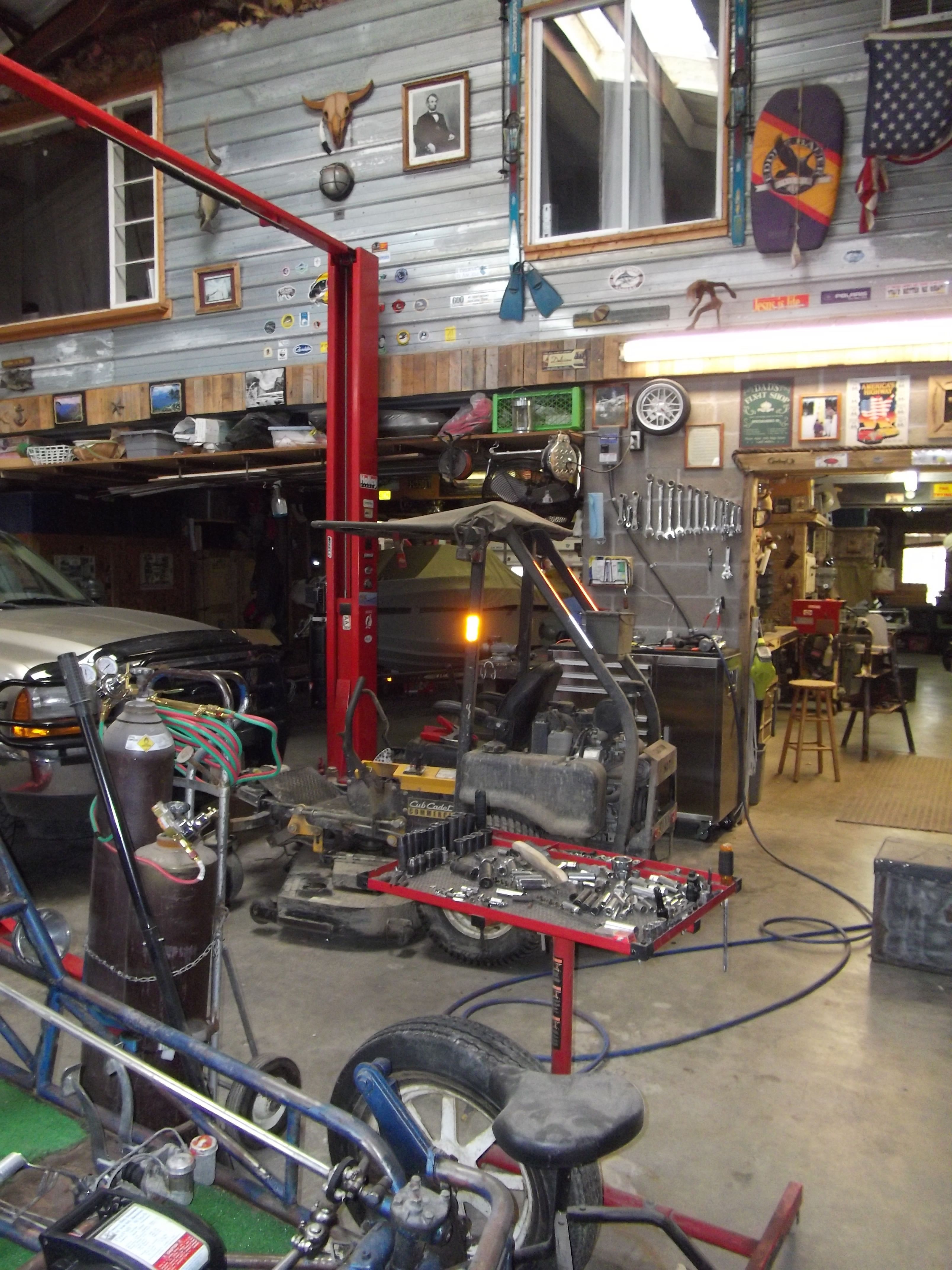 Best ideas about DIY Automotive Garage . Save or Pin Work Shop with auto lift Now.