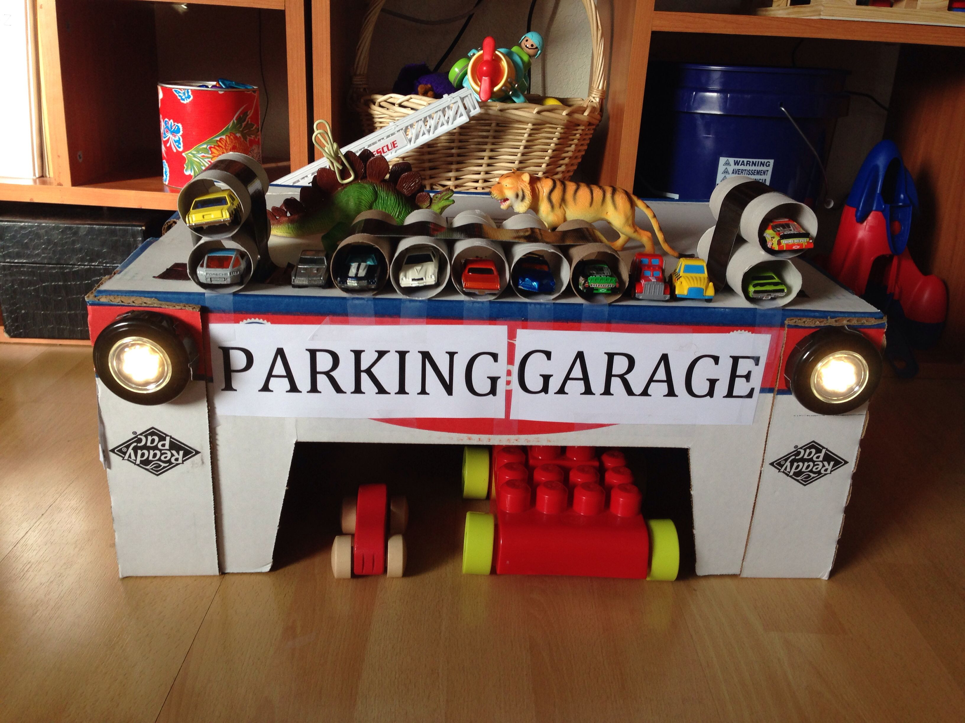 Best ideas about DIY Car Garage . Save or Pin DIY toy parking garage Cardboard box from Costco and Now.