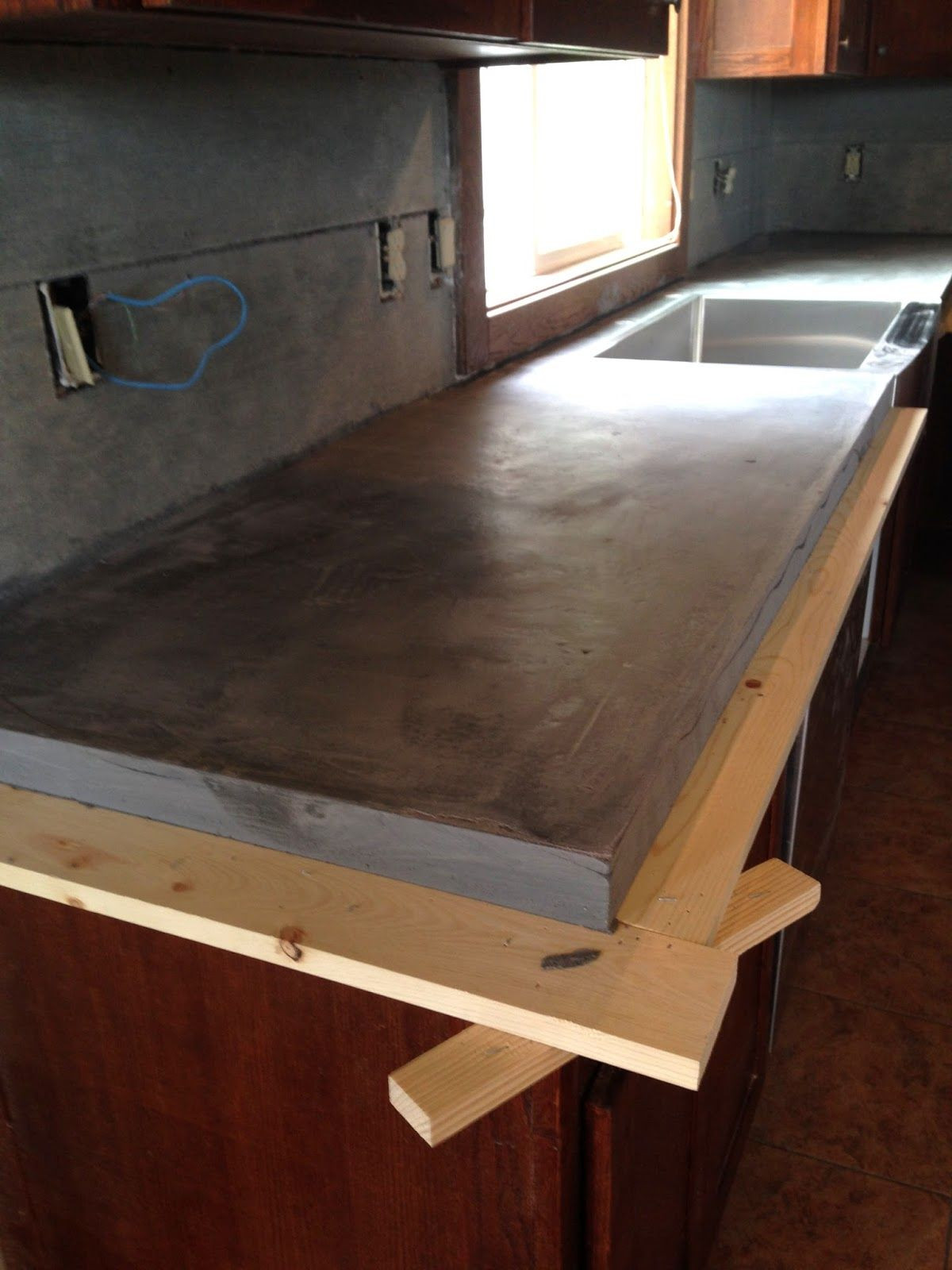 Best ideas about DIY Concrete Countertops Over Laminate . Save or Pin DIY Concrete Counters Poured over Laminate Now.