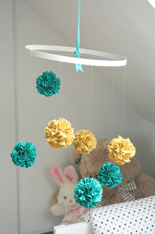 Best ideas about DIY Crib Mobiles . Save or Pin Bright DIY Fabric Pom Pom Baby Crib Mobile To Make Now.