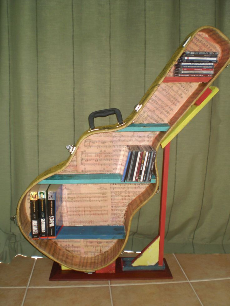 Best ideas about DIY Guitar Case . Save or Pin A guitar case re purposed into a CD Book shelf Decoupage Now.
