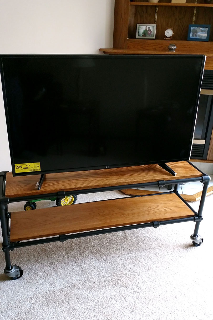 Best ideas about DIY Industrial Tv Stand . Save or Pin DIY Rolling Industrial Pipe TV Stand Now.