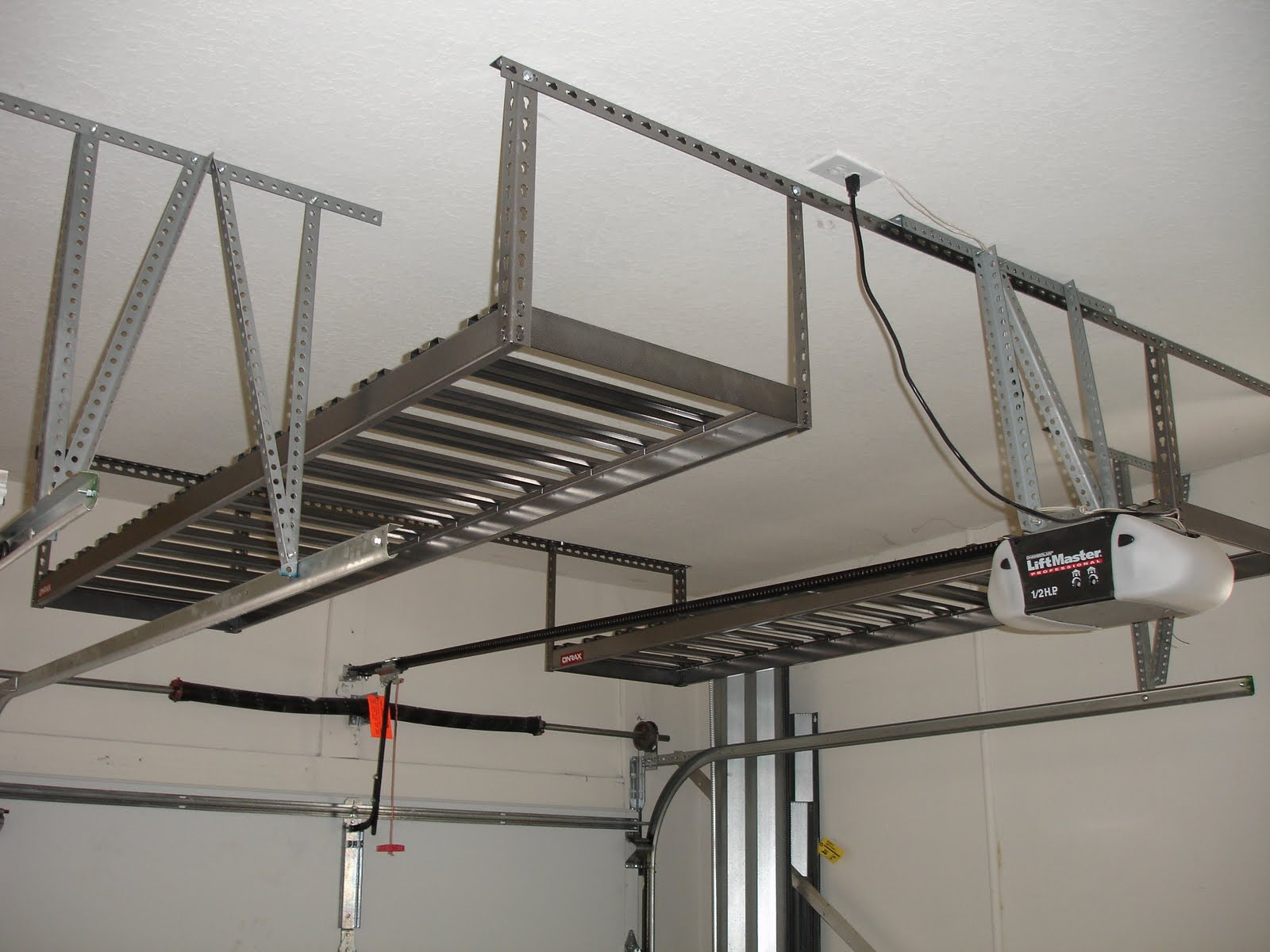 Best ideas about DIY Overhead Garage Storage Plans . Save or Pin Crowded Garage Overhead Storage Diy with White Wall Applied Now.