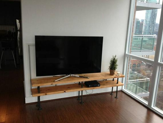 Best ideas about DIY Pipe Tv Stand . Save or Pin Industrial pipe and wood TV stand entertainment unit Now.