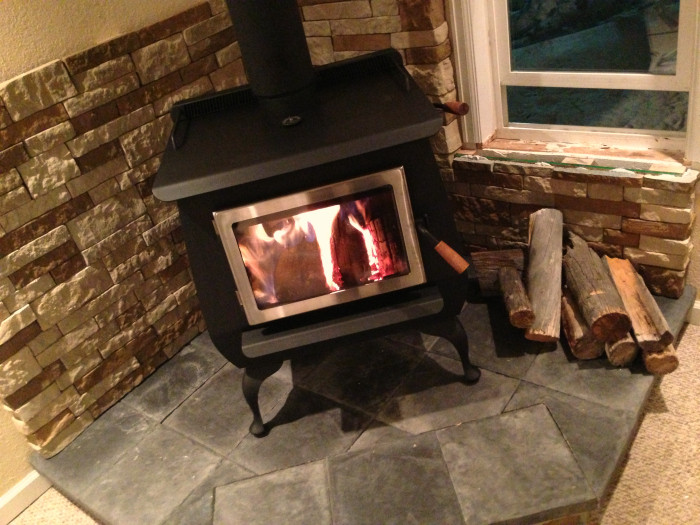 Best ideas about DIY Stone Wall Behind Wood Stove . Save or Pin Our DIY Wood Stove Installation • The Prairie Homestead Now.
